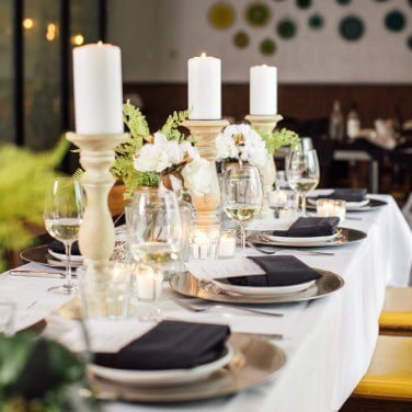 Private dining table with candles and decorations.